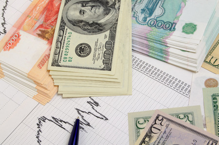 financial: Stacks of money, rubles and dollars on financial graph Stock Photo