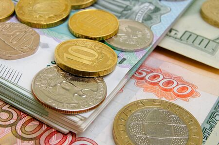different countries: Coins and banknotes of different countries on the plane.