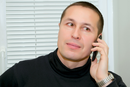 caller: A man talking on a cell phone. Stock Photo