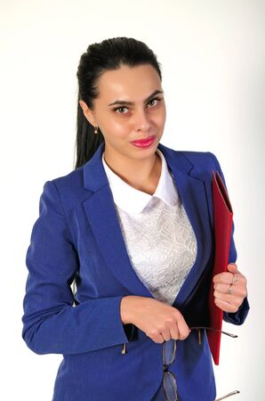 Young, beautiful girl in the jacket on a light background.