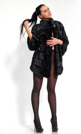 long legged: Beautiful, long-legged girl in pantyhose and a mink coat.