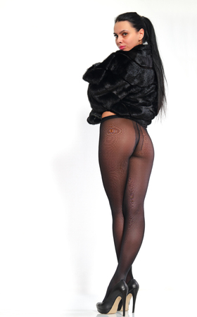long stockings: Beautiful, long-legged girl in pantyhose and a mink coat.