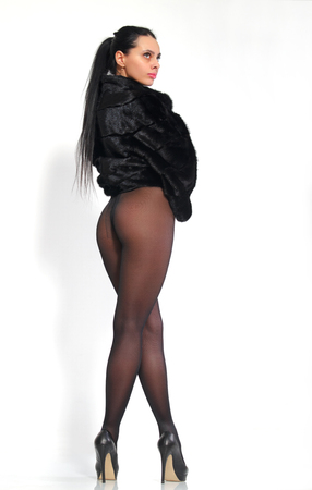sexy stockings: Beautiful, long-legged girl in pantyhose and a mink coat.