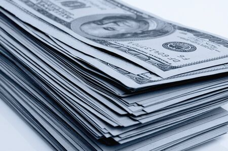 cashing: Cash dollars lying on the plane. Stock Photo