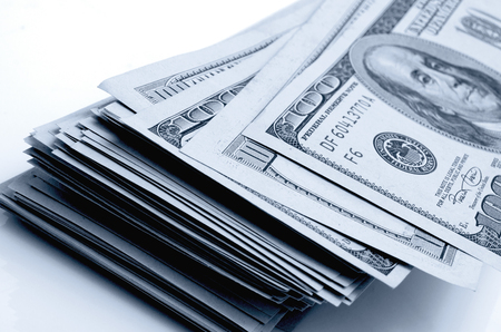 financial cash: Cash dollars lying on the plane. Stock Photo