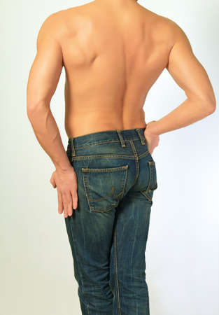 bluejeans: Mans body in jeans back of on a light background. Stock Photo