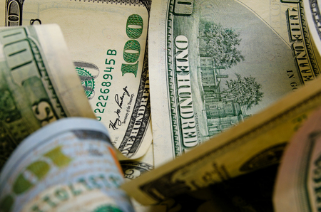 denominations: Cash dollars in various denominations on the plane.