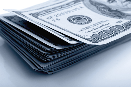 cashing: Cash dollars in various denominations on the plane.