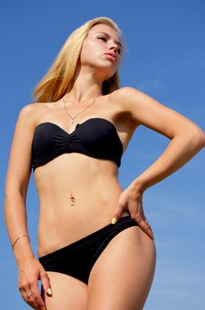 sunning: Sexy young girl in bikini sunning. Stock Photo