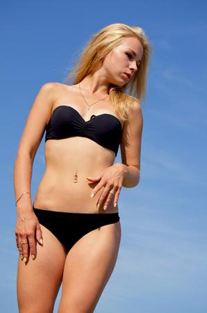 Sexy young girl in bikini sunning. Stock Photo