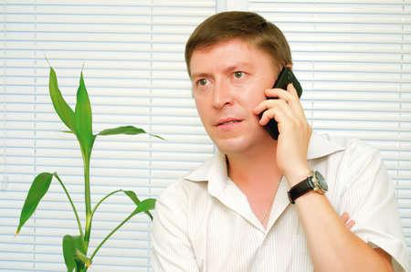 Businessman talking on a cell phone. Stock fotó
