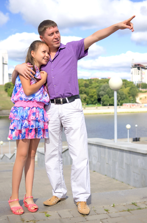 Dad and daughter walking around the city. Stock Photo