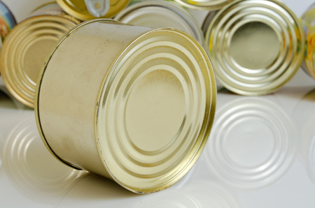 Canned food in tins on a light background.