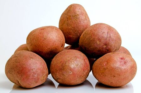 Potatoes pink closeup on a light background.