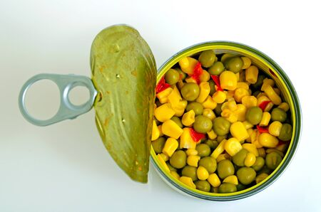 Canned salad of green peas, corn and red pepper. Stock Photo