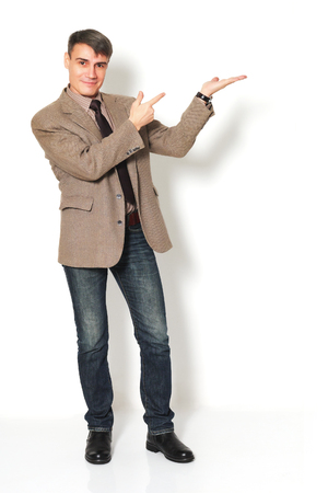 Businessman wearing a jacket shirt and jeans on light background.