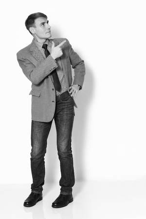 reasons: Businessman wearing a jacket shirt and jeans on light background.