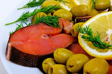 Salted pink salmon with lemon, olives and dill.