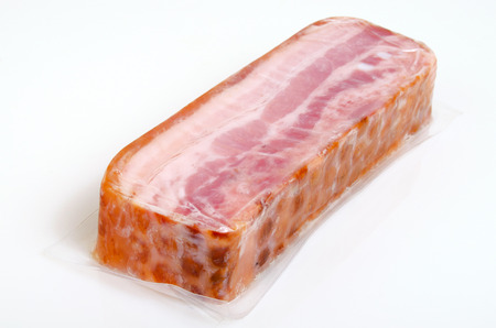 Bacon smoked and boiled, from pork, in vacuum packing. Stock fotó