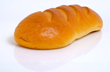 A loaf rifled of wheat bread on a light background. Stok Fotoğraf