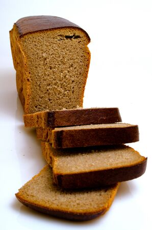 carbohydrates: Russian bread, rye-wheat, Darnitsky on a light background. Stock Photo