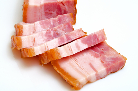 Bacon smoked and boiled from pork on a light background. Stock fotó