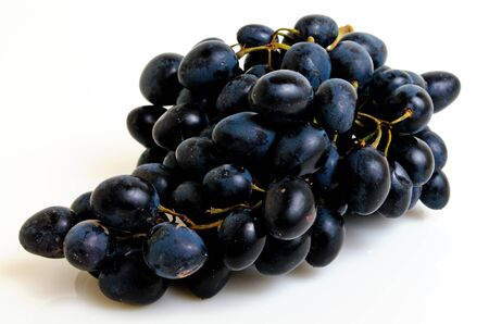 Bunch of dark grapes on a light background.