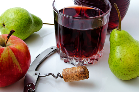 Wine and fruit on a light background close-up.