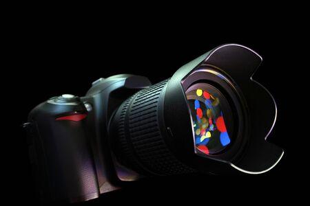 digital photo camera on black background