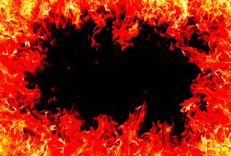 engulfed: fire and flames on a black background Stock Photo