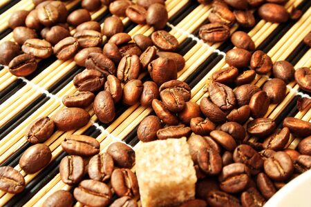 cup coffee and reed sugar photo