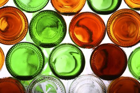green recycling: Bottoms of empty glass bottles on white