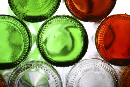 Bottoms of empty glass bottles on white photo