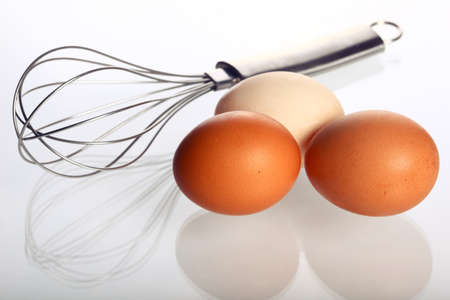 cooking implement: Eggs and whisk