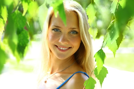 young beautiful blond female with long hair photo