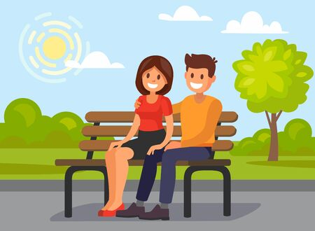 Couple outdoors in the park sitting.
