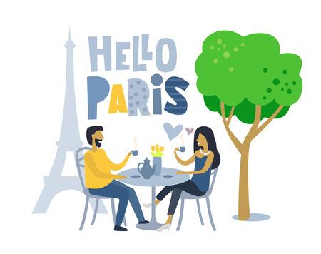 Couple siting at Parisian cafe.