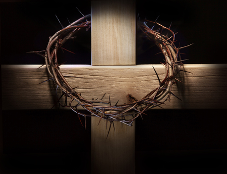 Crown of thorns and wooden cross Stock Photo