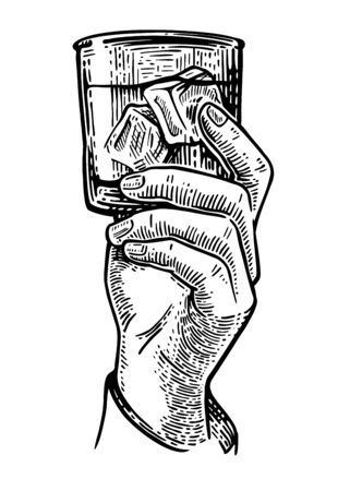 Male hand holding a glass of alcohol