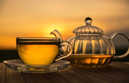glass cup and teapot sunset background Stock fotó