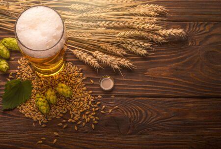 Beer in mug on wooden table