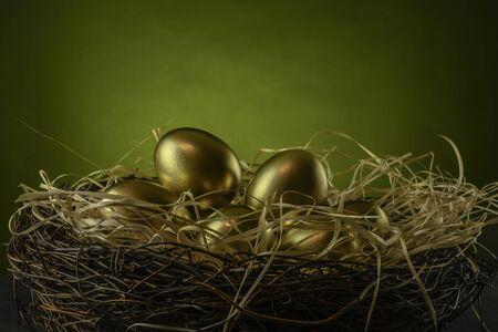 several golden chicken eggs in a nest Stock fotó