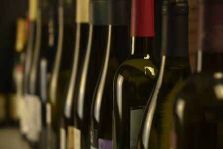 many bottles of wine stand in a row