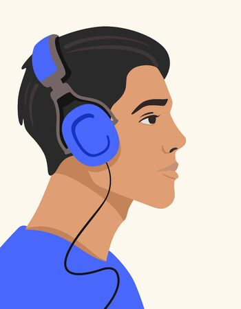 young man listening to music on headphones Standard-Bild - 147413399