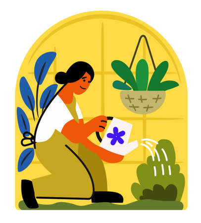 girl in a greenhouse watering a plant