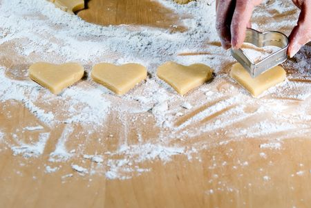 gouged: Heart ramekins are gouged in the dough Stock Photo