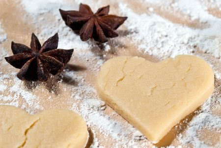 gouged: Heart shape gouged with star anise in the flour Stock Photo