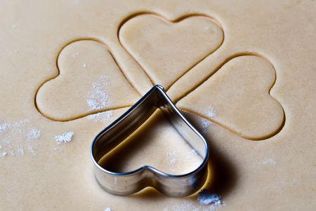 gouged: four heart ramekins gouged in the dough Stock Photo