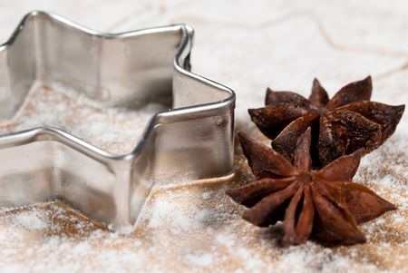 Star-shaped and star anise are in the flour Close up photo
