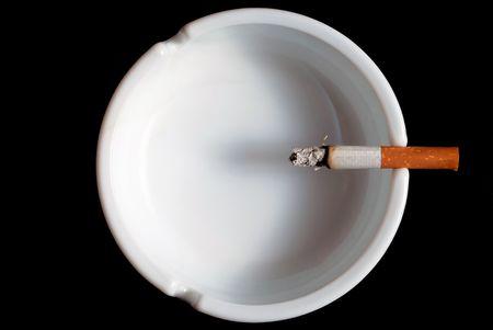 expectancy: burning cigarette in the ashtray white on black background